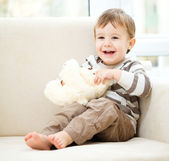 Portrait of a little boy with his teddy bear — Stock Photo
