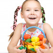 Little girl with basket full of colorful eggs — Stock Photo