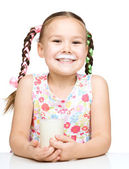 Cute little girl showing milk moustache — Stock Photo