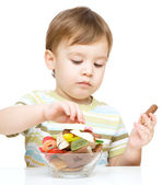 Portrait of a boy with candies — Stock Photo