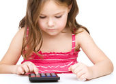 Little girl is using calculator — Stock Photo