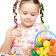 Little girl is painting eggs preparing for Easter — Stock Photo #21743243