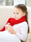 Ill little girl is reading thermometer — Stock Photo