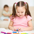 Little girl is playing with plasticine — Stock Photo #21770053