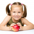 Little girl with red apple — Stock Photo #21961139