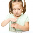 Little girl is counting dollars — Stock Photo #21961179