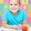 Little girl is writing using pen — Stock Photo #21961767