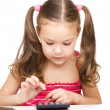 Little girl is using calculator — Stock Photo #21962339
