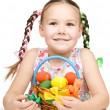 Little girl with basket full of colorful eggs — Stock Photo #22010693