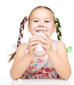 Cute little girl showing milk moustache — Stock Photo