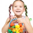 Little girl with basket full of colorful eggs — Stock Photo #22470617