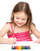 Little girl is drawing using colorful crayons — Stock Photo
