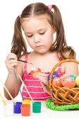 Little girl is painting eggs preparing for Easter — Stock Photo