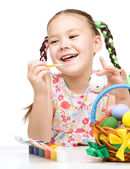 Little girl preparing eggs for Easter — Stock Photo