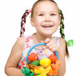 Little girl with basket full of colorful eggs — Stock Photo #22595339