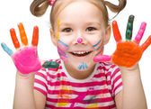 Portrait of a cute girl playing with paints — Foto Stock