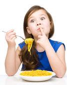 Little girl is eating spaghetti — Stock Photo