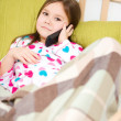 Cute little girl is talking on cell phone — Stock Photo #23044794