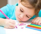 Cute cheerful child drawing using felt-tip pen — Stock Photo