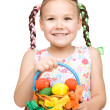 Little girl with basket full of colorful eggs — Stock Photo #23067600