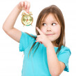 Little girl is holding small alarm clock — Stock Photo