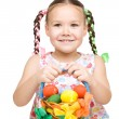 Little girl with basket full of colorful eggs — Stock Photo #23321706