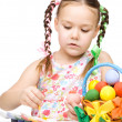 Little girl is painting eggs preparing for Easter — Stock Photo