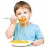 Little boy is eating spaghetti — Stock Photo #23438994