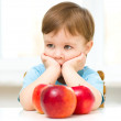 Portrait of a sad little boy with apples — Stock Photo