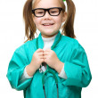 Cute little girl is playing doctor — Stock Photo #23550659