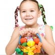 Little girl with basket full of colorful eggs — Stock Photo #23870911