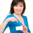Young woman is holding visit card — Stock Photo