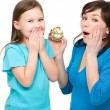 Stock Photo: Little girl and her mother are anxious about time