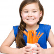 Cute little girl is eating carrot — Stock Photo #23965851