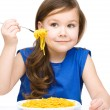 Little girl is eating spaghetti — Stock Photo #23965887