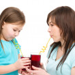 Mother and her daughter are drinking juice — Stock Photo