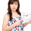 Young woman is holding big clock — Stock Photo