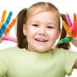Portrait of a cute girl playing with paints — Stock Photo #24508531