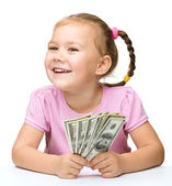 Little girl with dollars — Stockfoto