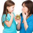 Little girl and her mother are anxious about time — Stock Photo #24521041