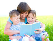 Family is reading book — Stock Photo