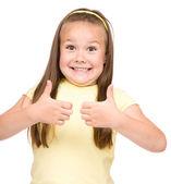 Küçük kız hareketi yukarı gösteriliyor — Stok fotoğraf