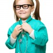 Cute little girl is playing doctor — Stockfoto