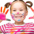 Stock Photo: Portrait of a cute girl playing with paints
