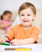 Little boy is drawing on white paper — Stock Photo