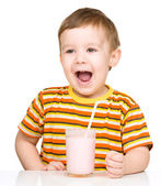 Cute little boy with a glass of milk — Stock Photo