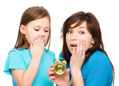 Little girl and her mother are anxious about time — Stock Photo