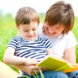 Mother is reading book for her child — Stock Photo