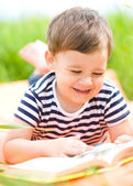 Little boy is reading book — Stock Photo