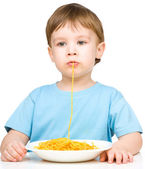 Little boy is eating spaghetti — Stock Photo